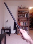 Holding the Engraved Wand